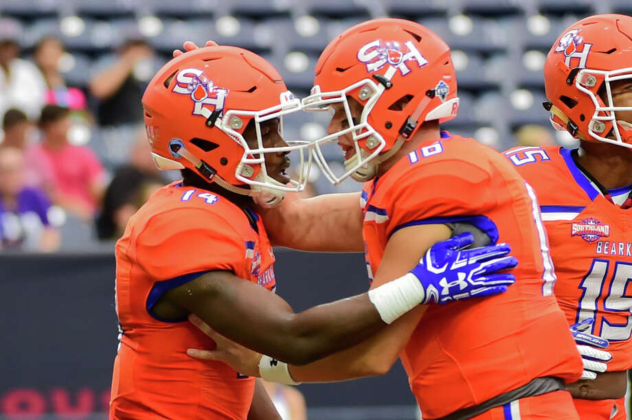 HOUSTON, TX - OCTOBER 07: Sam Houston State Bearkats quarterback Jeremiah Briscoe (16) congratulates Sam Houston State Bearkats wide receiver Davion Davis (14) after they connected on a touchdown pass during the Battle of the Piney Woods football game between Stephen F. Austin Lumberjacks and the Sam Houston State Bearkats on October 7, 2017 at NRG Stadium in Houston, Texas.  (Photo by Ken Murray/Icon Sportswire via Getty Images) Photo: Icon Sportswire/Icon Sportswire Via Getty Images / ©Icon Sportswire (A Division of XML Team Solutions) All Rights Reserved contact: info@iconsportswire.com http://iconsportswire.c