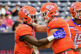 HOUSTON, TX - OCTOBER 07: Sam Houston State Bearkats quarterback Jeremiah Briscoe (16) congratulates Sam Houston State Bearkats wide receiver Davion Davis (14) after they connected on a touchdown pass during the Battle of the Piney Woods football game between Stephen F. Austin Lumberjacks and the Sam Houston State Bearkats on October 7, 2017 at NRG Stadium in Houston, Texas. (Photo by Ken Murray/Icon Sportswire via Getty Images)