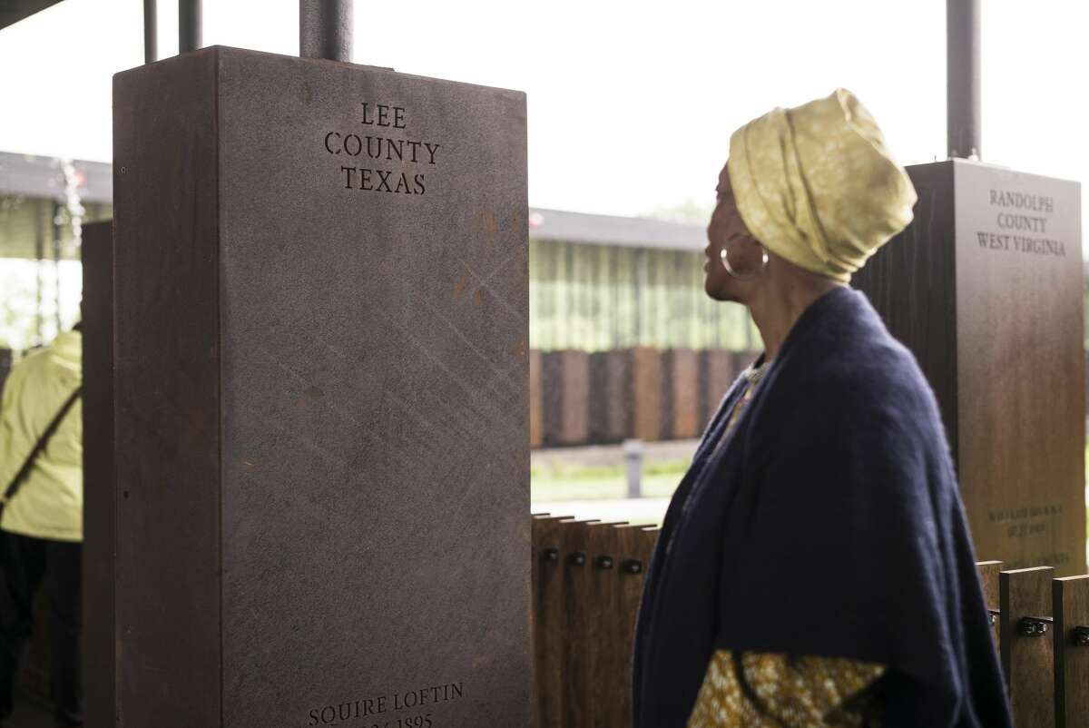 MONTGOMERY, AL - APRIL 26: Wretha Hudson, 73, discovers a marker commemorating lynchings in Lee County, Texas while visiting the National Memorial For Peace And Justice on April 26, 2018 in Montgomery, Alabama. Hudson, whose father's family came to Alabama from Lee County decades earlier, said the experience was overwhelming.