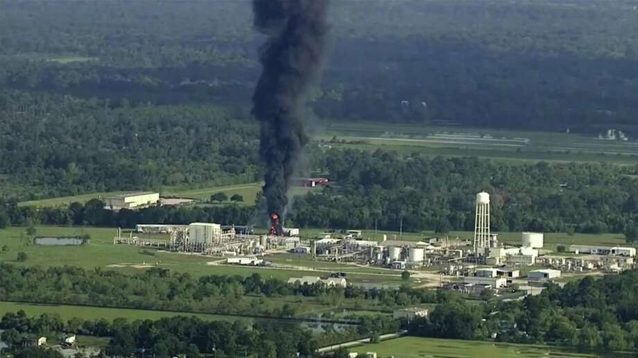 In this Sept. 1, 2017, file photo, smoke rises from the Arkema Inc. owned chemical plant in Crosby, near Houston, Texas. A Harris County grand jury on Friday indicted the French chemical company Arkema and two executives in connection with the release of toxic chemicals during the fire. Photo: /Associated Press / KTRK