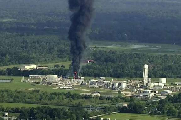 In this Sept. 1, 2017, file photo, smoke rises from the Arkema Inc. owned chemical plant in Crosby, near Houston, Texas. A Harris County grand jury on Friday indicted the French chemical company Arkema and two executives in connection with the release of toxic chemicals during the fire.