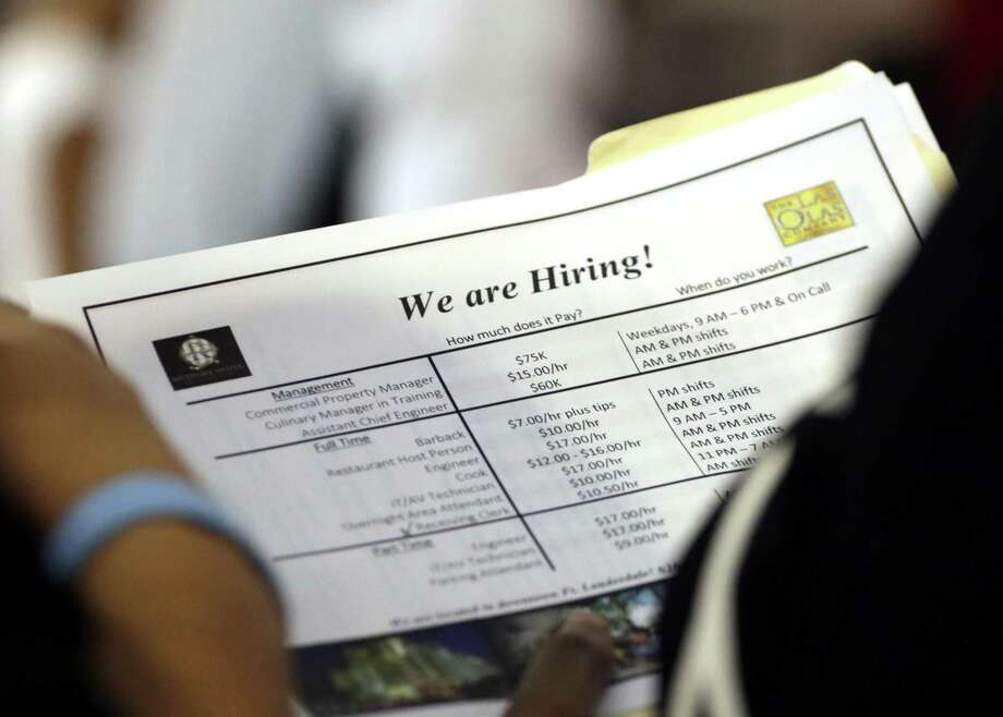 In this June 21, 2018 file photo, a job applicant looks at job listings for the Riverside Hotel at a job fair hosted by Job News South Florida, in Sunrise, Fla. Photo: Lynne Sladky /Associated Press / Copyright 2018 The Associated Press. All rights reserved.