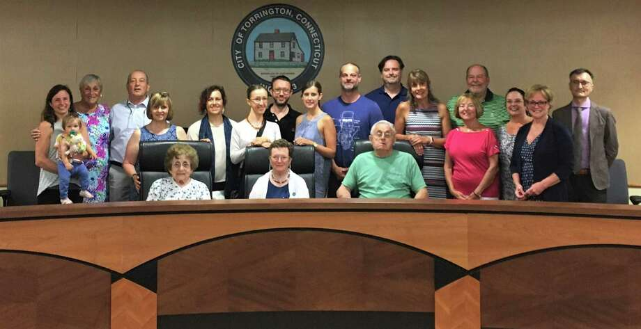 Nineteen relatives of the Bauce family visit with Mayor Elinor Carbone in the City Hall Auditorium. Seven of the group traveled from Italy for the first time to attend a family reunion. Photo: Contributed Photo