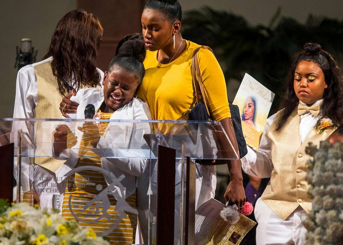 Augie Lewis, second left, niece of Nia Wilson, cries after reading a poem during a funeral service held for 18-year-old Nia Wilson of Oakland at Acts Full Gospel Church in Oakland on Friday, Aug. 3, 2018. Wilson was killed Sunday, July 22, 2018 at Macarthur Bart station in Oakland.