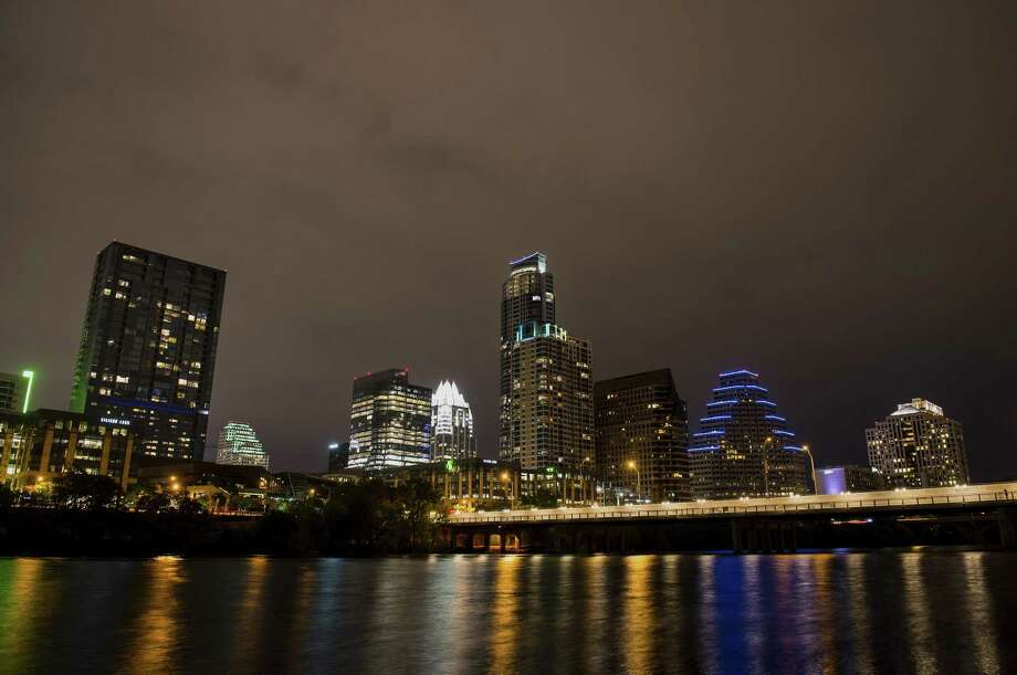 Buildings stand in the downtown skyline at night past the Colorado River in Austin in 2015. Because Stephen F. Austin advocated slavery as an economic necessity for Texas, should the city's name be changed? Photo: Matthew Busch /Bloomberg / © 2015 Bloomberg Finance LP