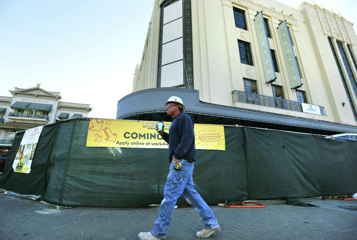 A construction worker walks past the site of The Historic Joske's Building at Rivercenter Mall which took the name The Shops at Rivercenter Dec. 4, 2015. A developer is proposing a hotel atop the building.