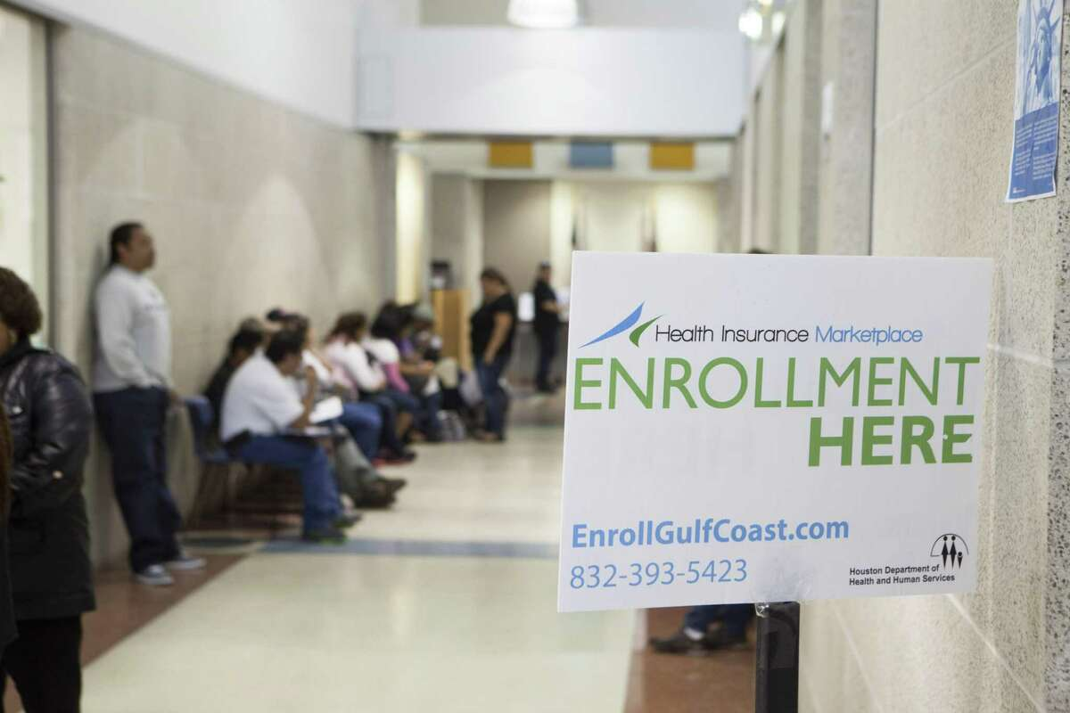 People wait to buy health insurance with the help of City of Houston application counselors at a service center in Houston March 31, 2014. While there have been inroads, Texas still leads the states in the number of uninsured residents.