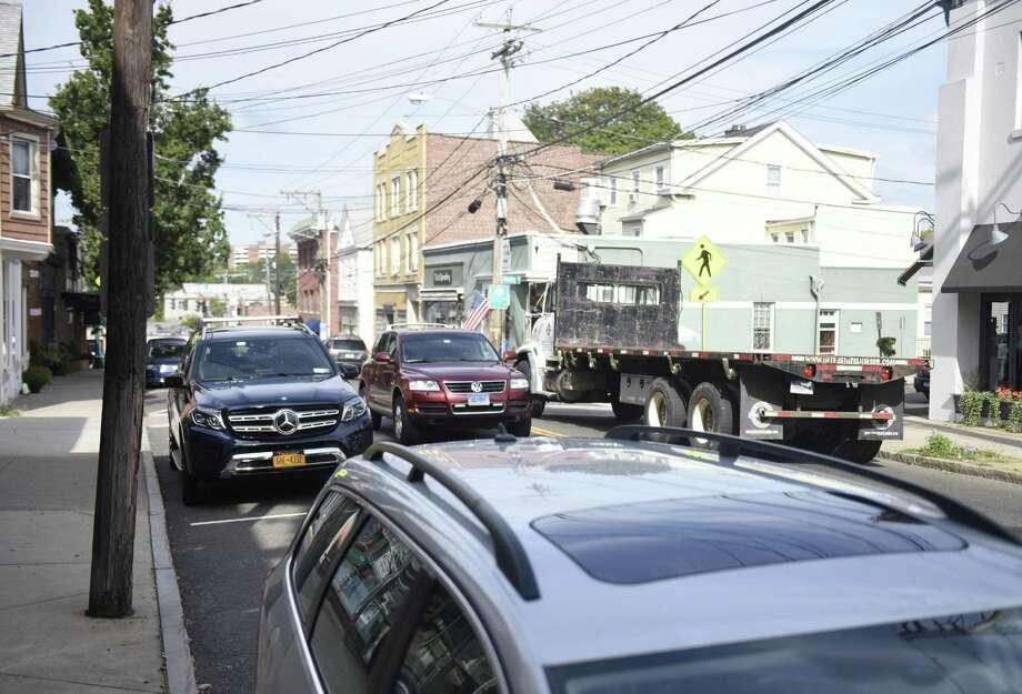 Traffic passes through Mill Street in the Byram section of Greenwich, Conn. Thursday, Aug. 21, 2017. Byram businesses have noticed a parking shortage downtown, largely resulting from Port Chester employees parking in the free Byram municipal lot and then getting a ride or walking over to Port Chester. Photo: Tyler Sizemore / Hearst Connecticut Media / Greenwich Time