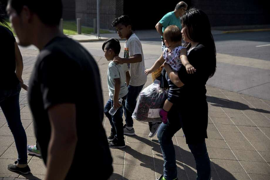 Immigrant families at a bus station in McAllen July 2. As the Trump administration has rushed to reunite thousands of children separated from their parents under a zero-tolerance policy on border enforcement, it is now left with 700 or more cases that have been more difficult to solve. Photo: ILANA PANICH-LINSMAN /NYT / NYTNS