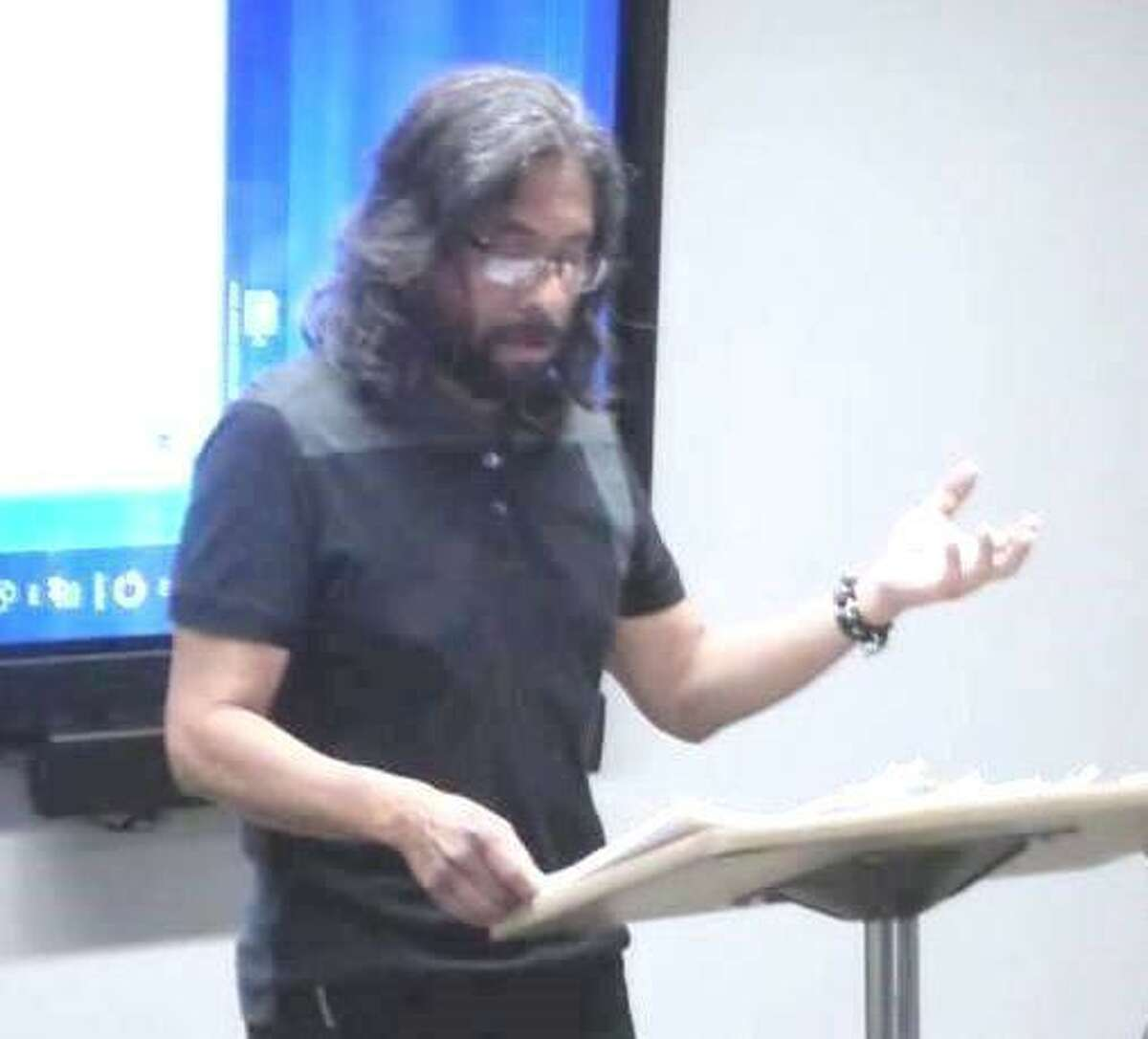 Fernando Flores, a long-time fixture in the local poetry scene, lectures on poetry recently.