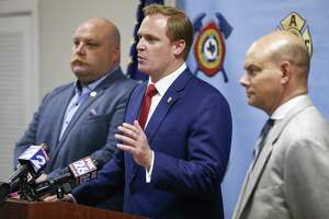 """Houston Professional Fire Fighters Association president Patrick """"Marty"""" Lancton, center, speaks to the media after a judge sided with the association that Houston's City Hall improperly electioneered against firefighters pay measure Tuesday July 31, 2018 in Houston."""