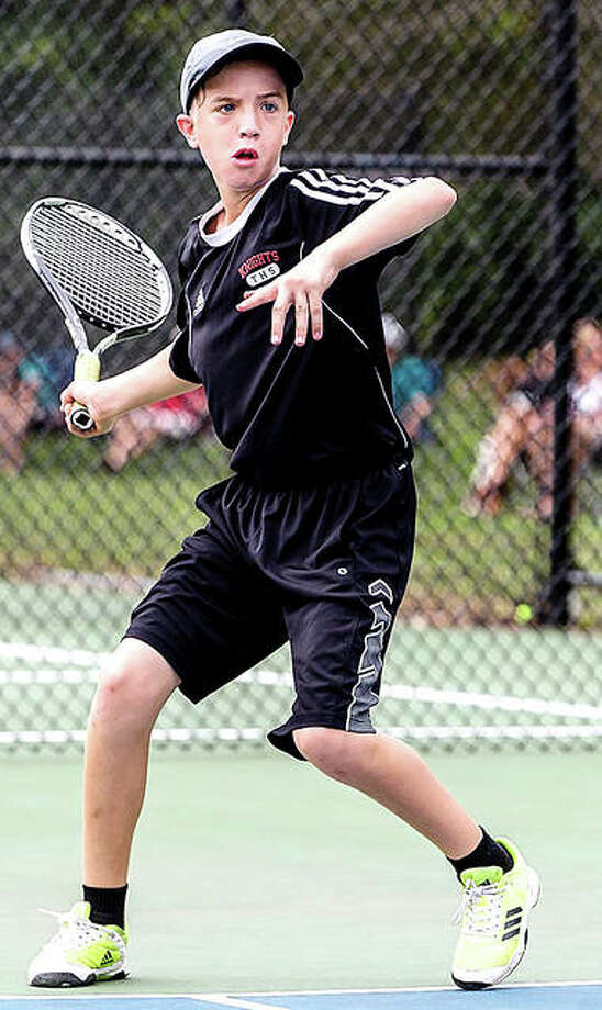 Marc Froidcoeur of Troy eyes the ball during a match in the Alton Junior Open. Froidcoeur went on to win the consolation final. Photo:       Photo By John Goldacker