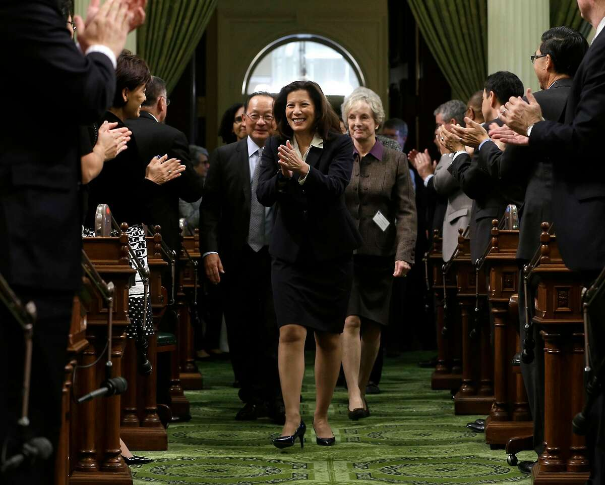 California Supreme Court Chief Justice Tani Cantil Sakauye returns lawmakers applause as she is escorted into the Assembly Chambers to deliver her annual State of the Judiciary address before a joint session of the Legislature,at the Capitol in Sacramento, Calif., Monday, March 23, 2015. Cantil-Sakauye, who was appointed to the bench by former Gov. Arnold Schwarzenegger in 2010, told lawmakers that California's court system is in stronger financial shape after years of budget cuts, but it needs the Legislature's help and more funding to adopt innovative and efficient practices. (AP Photo/Rich Pedroncelli)