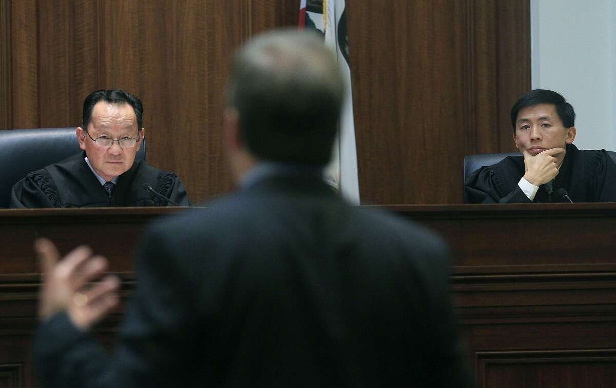 FILE - In this Nov. 10, 2011, file photo, Justice Ming Chin, left, and Justice Goodwin Liu, right, listen as Ross Moody of the San Francisco office of the Attorney General, center, speaks during a proceeding at the California Supreme Court in San Francisco. A California mom's legal battle over custody of her out-of-control daughter is raising questions about the best way to deal with wayward children. The California Supreme Court ruled Thursday, July 20, 2017, that if children face substantial danger, the state can take custody of them even if the parents are trying to keep them safe. In Thursday�s ruling, Chin said a delinquency finding �may follow the minor throughout his or her life, � while Liu acknowledged finding that a parent is inadequate, �even when the parent is not at fault, can carry a painful stigma.� (AP Photo/Jeff Chiu/Pool, File)