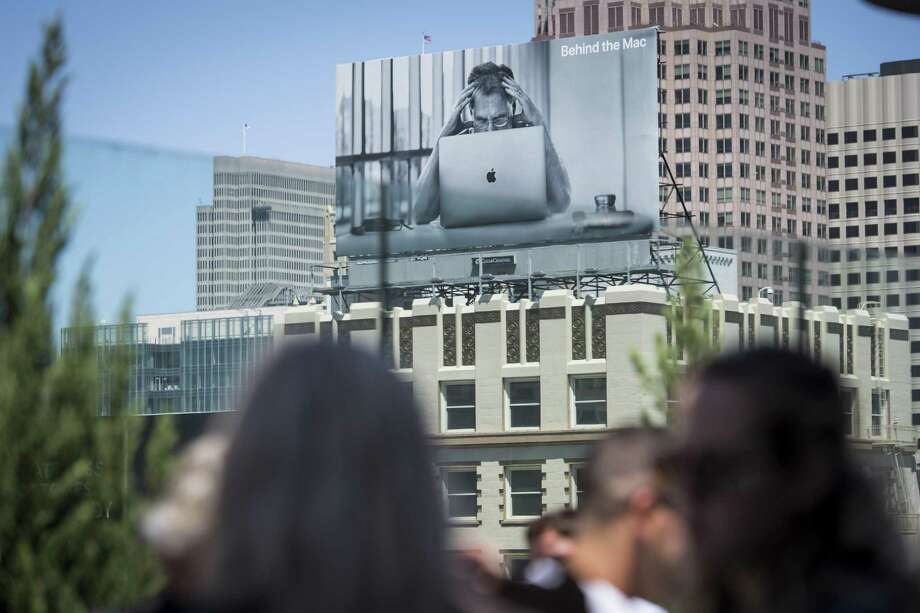 An Apple Inc. billboard stands on a building in Union Square in San Francisco, California, U.S., on Thursday, August 2, 2018. Apple Inc. shares climbed 3 percent on Thursday, pushing it above $1 trillion in market capitalization, the first U.S. company to reach the milestone. Photo: David Paul Morris /Bloomberg / © 2018 Bloomberg Finance LP