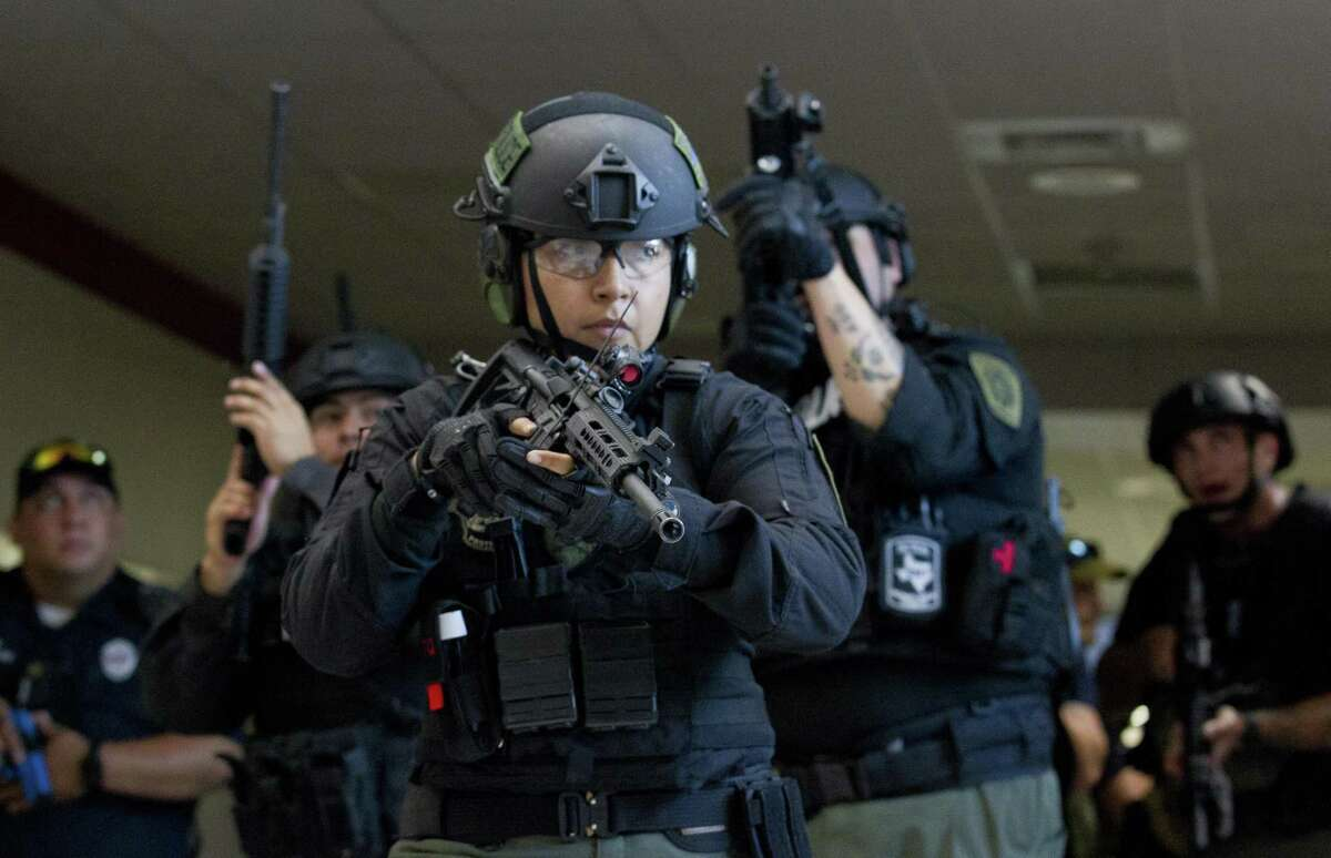 The East Montgomery County Strategic Response Team engages in active-shooter training at Splendora High School, near Houston, last month. While such exercises are necessary, some experts suggest less militaristic training.