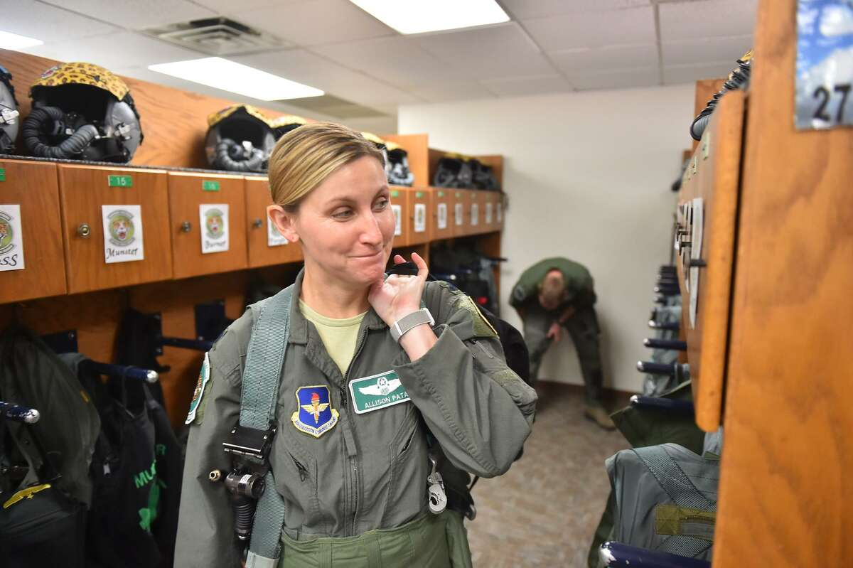 Air Force Lt. Col. Allison Patak is suited up prior to a training flight from Joint Base San Antonio Roandolph.