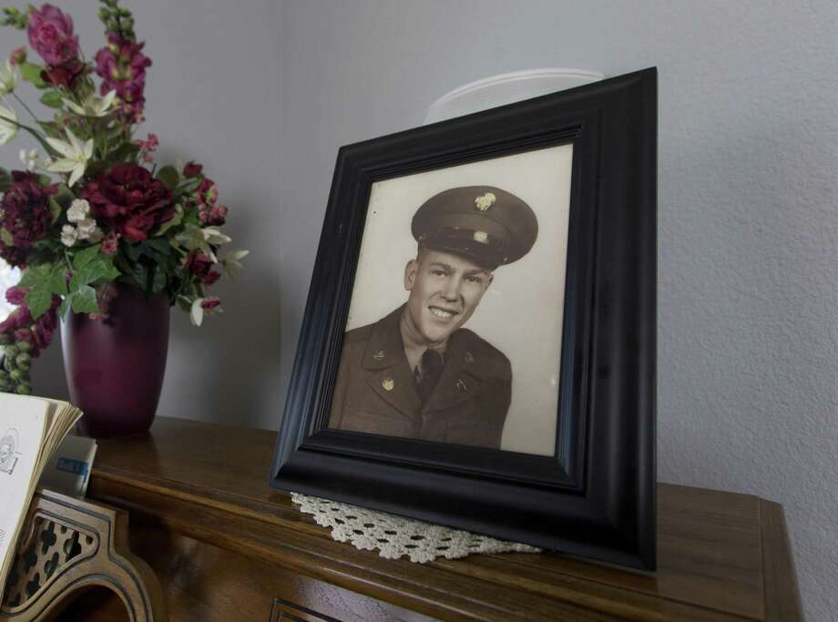 A portrait of Army private Carroll Ruthstrom is seen in the home of his brother Lester on Friday, Aug. 3, 2018, in Conroe. Lester, whose brother was reported as missing in action in 1950, will fly to Washington D.C. on Aug. 6 to attend an annual conference for families of Korean MIAs. Photo: Jason Fochtman, Staff Photographer / Houston Chronicle / © 2018 Houston Chronicle
