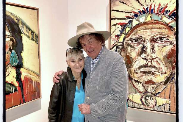 Gail Glasser and her pal, artist Ira Yeager at the opening of his Calistoga gallery. July 8, 2018.