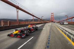 Daniel Ricciardo speeds across the Golden Gate Bridge in an Aston Martin Red Bull RB7. A new video released Thursday by Red Bull Racing follows Ricciardo zipping around the streets of San Francisco before beginning a western road trip to Las Vegas.