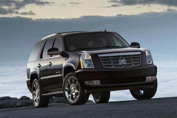 One of Agriculture Commissioner Sid Miller's assistant commissioners bought a 2007 Cadillac Escalade, like the one pictured, from Miller's political campaign, according to state records. Miller bought the SUV for the campaign sight unseen from the state government's surplus program in August after it was seized in a drug bust, his campaign said. But the vehicle was in poor shape, according to the Texas Facilities Commission. The state has sold 483 vehicles from its Austin storefront where it sells surplussed goods since September. (AP Photo/General Motors)