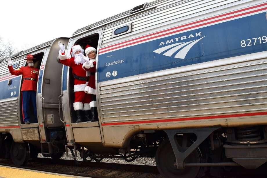 "Gunny Claus (a.k.a. USMC Ret. Gunnery Sgt. Bar Porter), Santa Claus (a.k.a. John Conte), Mrs. Claus, (a.k.a. Johanna Roman, wife of USMC Ret. Gunnery Sgt. Albert ""Vinny"" Roman, Jr., Capital Region's Toys For Tots coordinator). (Provided)"
