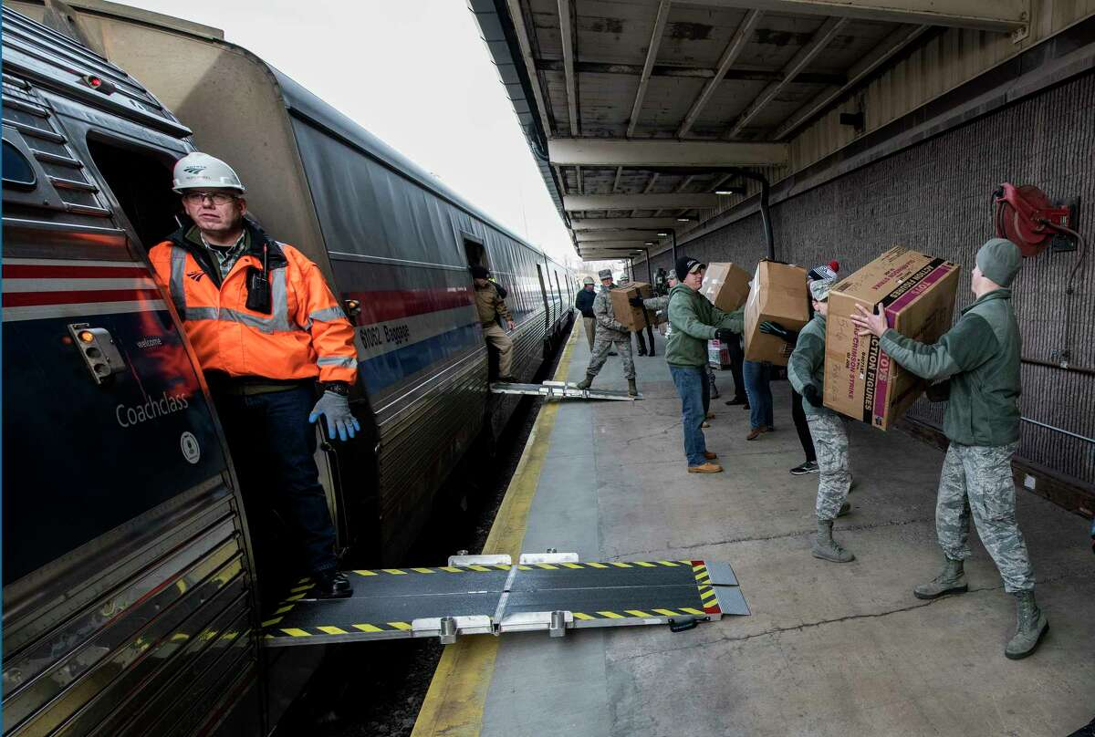 Two tractor trailers were unloaded and reloaded on to waiting rail cars for distribution by Toys for Tots by volunteers from various military services, South Colonie Schools, SEFCU and Clifton Park EMS on Thursday, Nov. 30, 2017, at the Amtrak Service Shops in Rensselaer, N.Y. (Skip Dickstein/ Times Union)