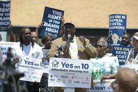 IMAGE DISTRIBUTED FOR YES ON 10 CAMPAIGN - Southern Christian Leadership Conference-Greater Southern California President Rev. William D. Smart Jr., speaks while AFSCME 3090 Past President Alice Goff looks on at the Yes on 10 campaign press conference at Vision Theater on Monday, July 20, 2018 in Los Angeles. African-American leaders come together with Los Angeles Councilmember Marqueece Harris-Dawson to decry gentrification and announce their support for Proposition 10 on the November ballot in California to expand rent control. (Jordan Strauss/AP Images for Yes on 10 campaign)