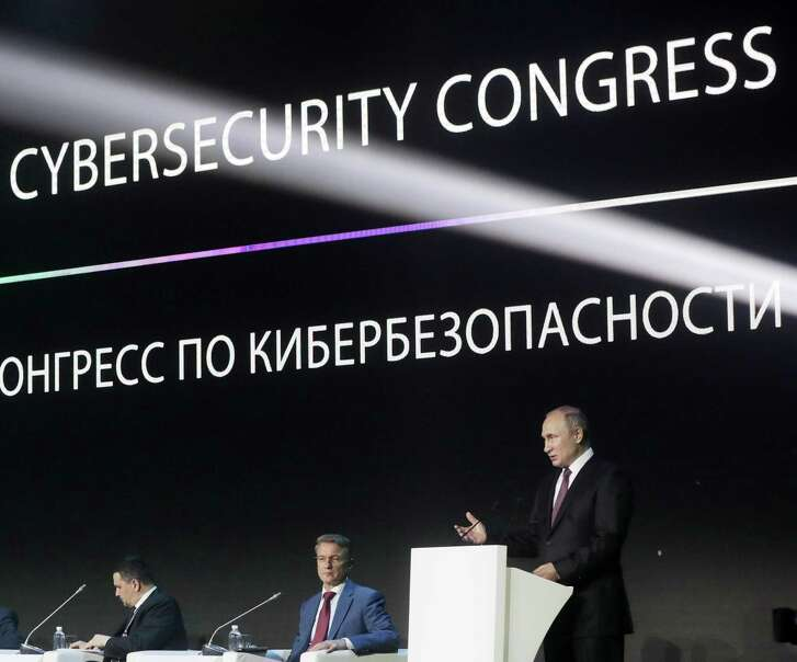 Russian President Vladimir Putin, shown here speaking at a cybersecurity conference in Moscow on July 6, 2018, is preparing his country for a cyber war. Why isn't president Trump?