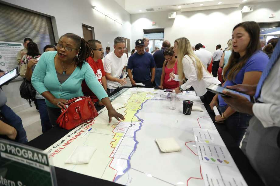 Homeowners pore over maps as Harris County held one in a series of public meetings on the $2.5 billion flood bond proposal at the El Franco Lee Community Center, Tuesday, July 17, 2018, in Houston. ( Karen Warren / Houston Chronicle ) Photo: Karen Warren, Staff / Houston Chronicle / © 2018 Houston Chronicle