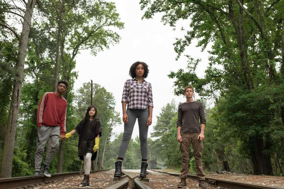 "This image released by  Twentieth Century Fox shows, from left, Skylan Brooks, Miya Cech, Amandla Stenberg and Harris Dickinson in a scene from ""The Darkest Minds."" (Daniel McFadden/Twentieth Century Fox via AP) Photo: Daniel McFadden / TM & © 2018 Twentieth Century Fox Film Corporation.  All Rights"