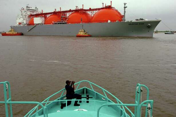 U.S. Coast Guard Lt. j.g. Niya J. Williams takes photos from the deck of the Sabine Pilot II as boats maneuver the Celestine River LNG vessel into position during the first arrival of liquified natural gas at the Sabine Pass LNG on April 11, 2008. The 145,000 cm-capacity vessel transported the cargo from Nigeria to the facility owned by Cheniere Energy Inc. China's proposal of 25 percent tariff on imports of U.S. liquefied natural gas could impede U.S. access to one of the world's largest LNG markets during a time of intense competition for global export dominance.
