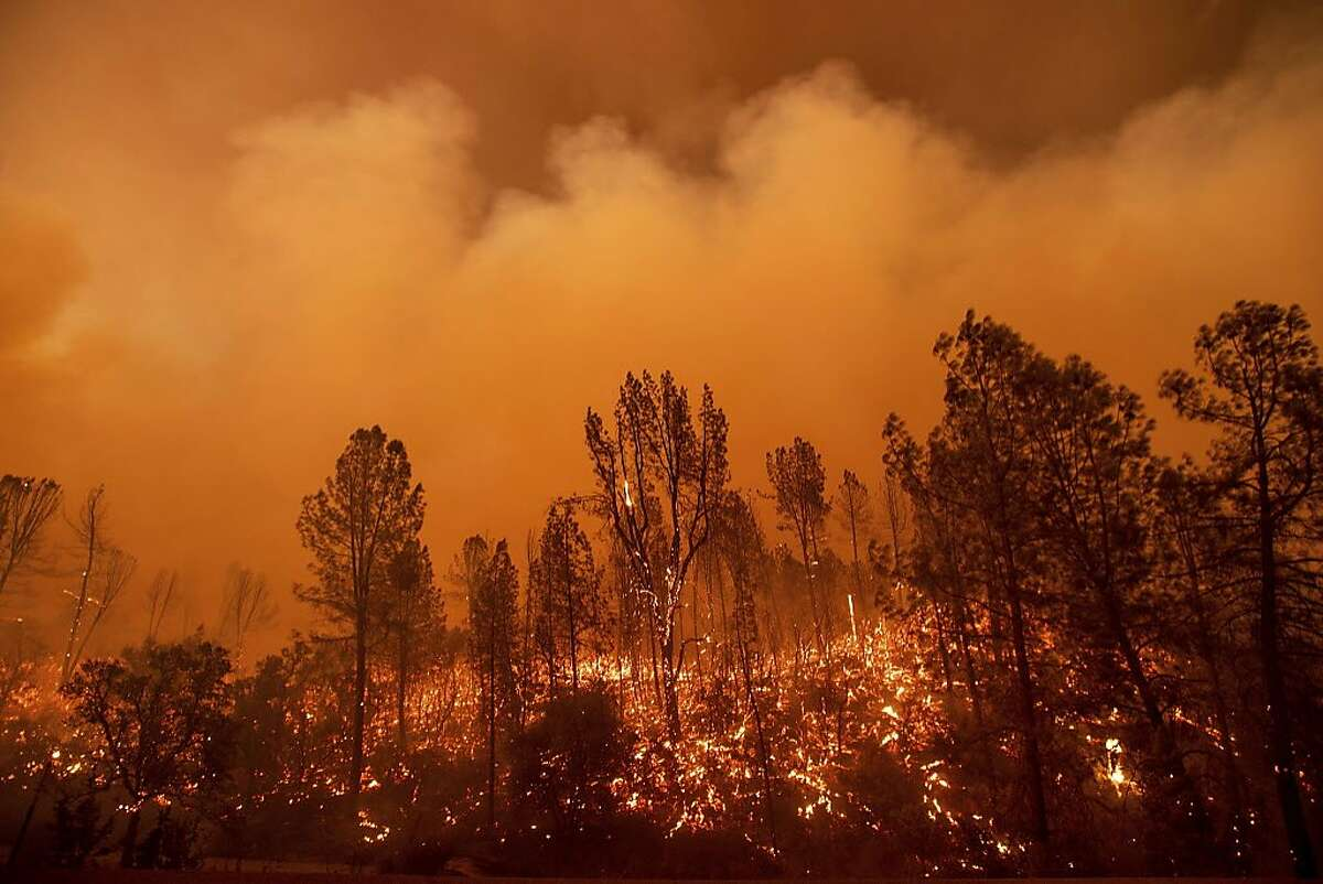 The Carr Fire burns along Highway 299 in Redding on July 26, 2018.