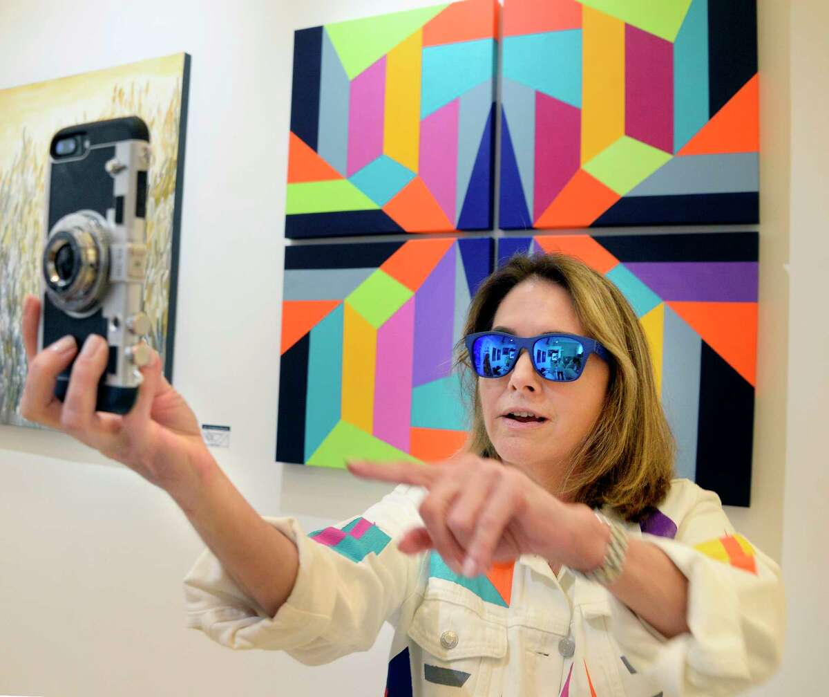 Artist MariaNela Perez from Florida takes a selfie with one of her works at the REVEAL International Contemporary Art Fair at the Center Center Friday August 3, 2018 in Saratoga Springs, NY. (John Carl D'Annibale/Times Union)