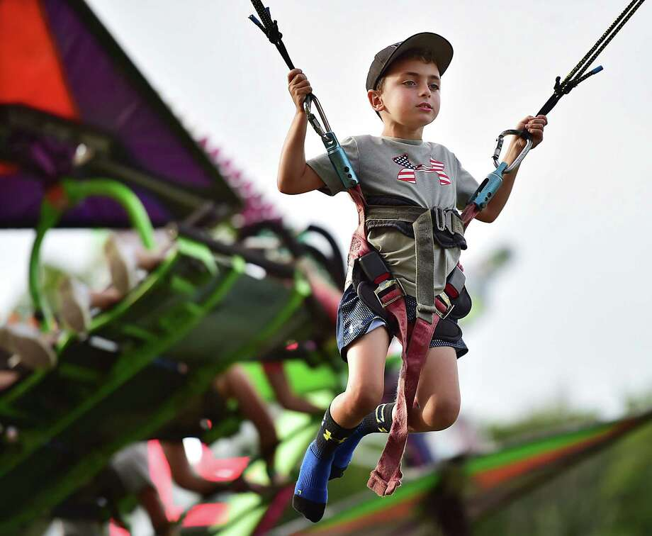 Tyler Ferraro, 7, of North Haven gets a birds-eye view from the Power Jump at the annual Orange Volunteer Firemen's Carnival at 525 Orange Center Road at the Orange Fairgrounds Friday, August 3, 2018. The carnival runs  August 4 from noon to midnight, and August noon - 5 p.m. Photo: Catherine Avalone, Hearst Connecticut Media / New Haven Register