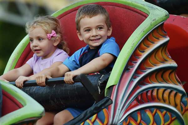 Carter Tonucci, 4, and his 2-year-old sister Emma, of Orange ride the Orient Express at the annual Orange Volunteer Firemen's Carnival at 525 Orange Center Road at the Orange Fairgrounds Friday, August 3, 2018. The carnival runs August 4 from noon to midnight, and August noon - 5 p.m.