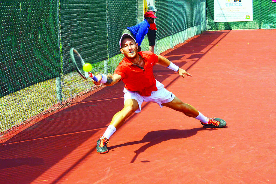 Or Ram-Harel reaches to make a forehand return during the singles championship of the USTA Edwardsville Futures last year at the Edwardsville High School Tennis Center. Photo: Matthew Kamp