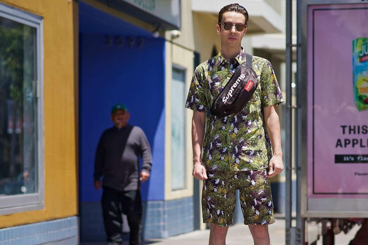 Sam Goldburg is wearing a Ripndip shirt and shorts, a Supreme bag, Adidas shoes. He's an engineer at Dolby.