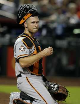 San Francisco Giants catcher Buster Posey (28) in the first inning during a baseball game against the Arizona Diamondbacks, Thursday, Aug. 2, 2018, in Phoenix. (AP Photo/Rick Scuteri)