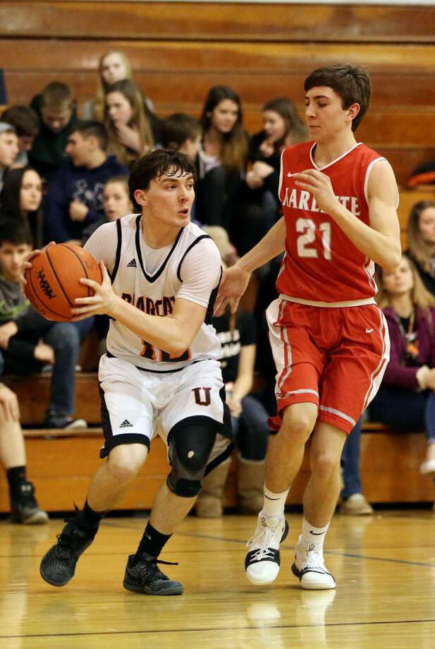 Former Ubly athlete Matthew Maikrzek (left) is shown here handing the ball against Marlette. Maikrzek played three sports his senior year (football, basketball and track) helping the Bearcats to a 90.2 percent of athletes who participated in multiple sports, according to a study conducted by the MHSAA. (Tribune File Photo)