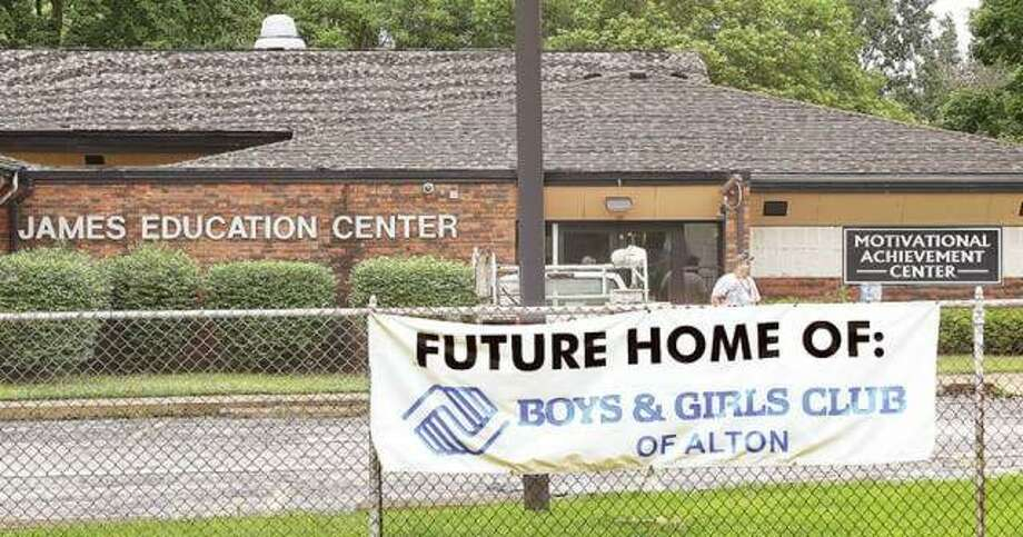 "A sign hanging on the chain-link fence outside the James Education Center earlier this year declares it the ""future home of: Boys & Girls Club of Alton."" The city of Alton's Plan Commission on Tuesday recommended the club be allowed to obtain a special use permit to operate in its future new home. Photo:       John Badman 