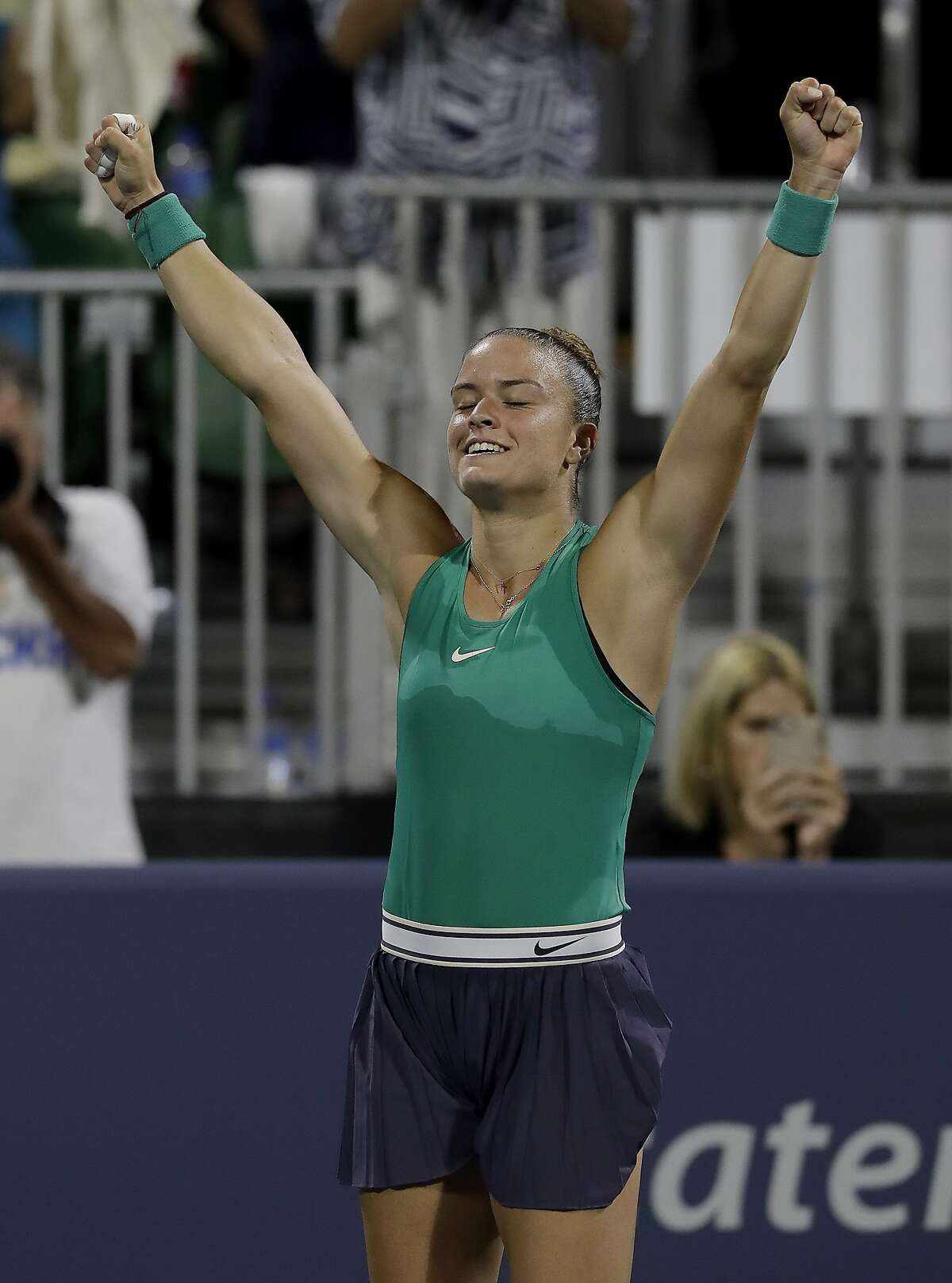Maria Sakkari, of Greece, celebrates after beating Venus Williams, of the United States, during the Mubadala Silicon Valley Classic tennis tournament in San Jose, Calif., Friday, Aug. 3, 2018. Sakkari won 6-4, 7-6 (2). (AP Photo/Jeff Chiu)