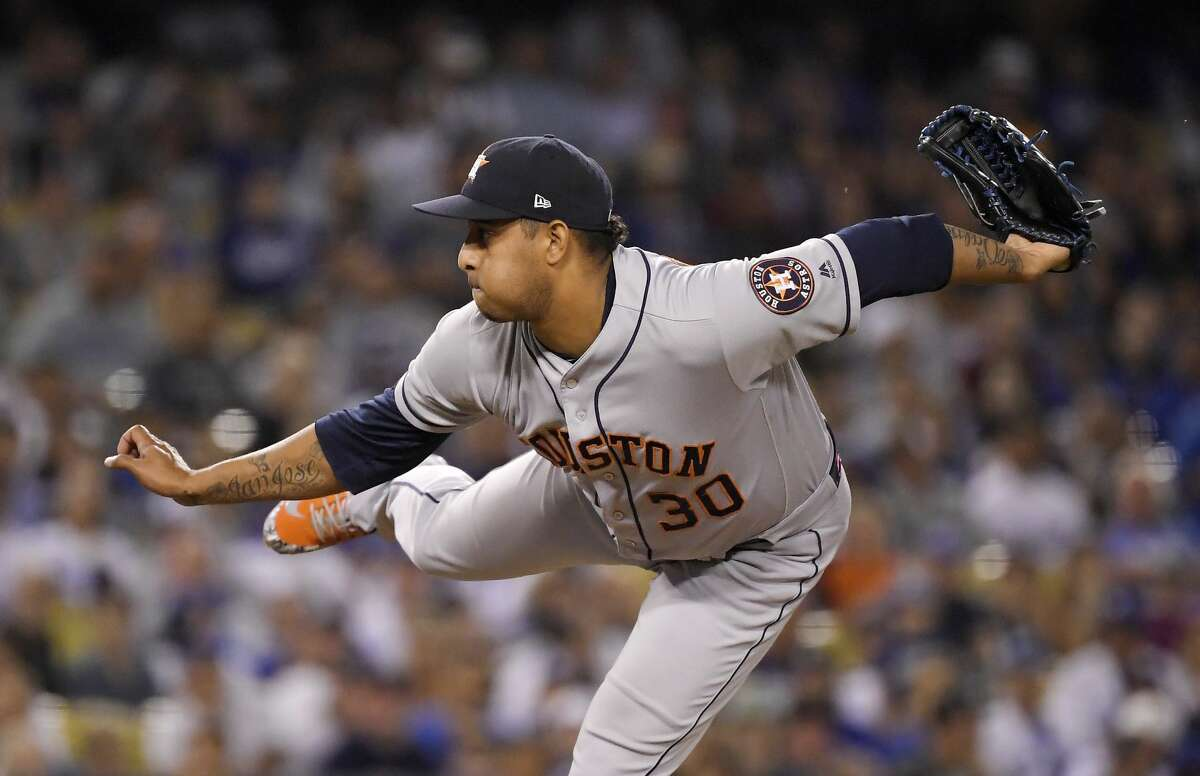 Houston Astros relief pitcher Hector Rondon throws during the ninth inning of the team's baseball game against the Los Angeles Dodgers on Friday, Aug. 3, 2018, in Los Angeles. (AP Photo/Mark J. Terrill)