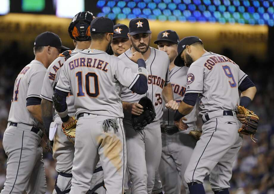 Houston Astros starting pitcher Justin Verlander, center, is congratulated after being taken out of the baseball game during the eighth inning against the Los Angeles Dodgers on Friday, Aug. 3, 2018, in Los Angeles. (AP Photo/Mark J. Terrill) Photo: Mark J. Terrill/Associated Press