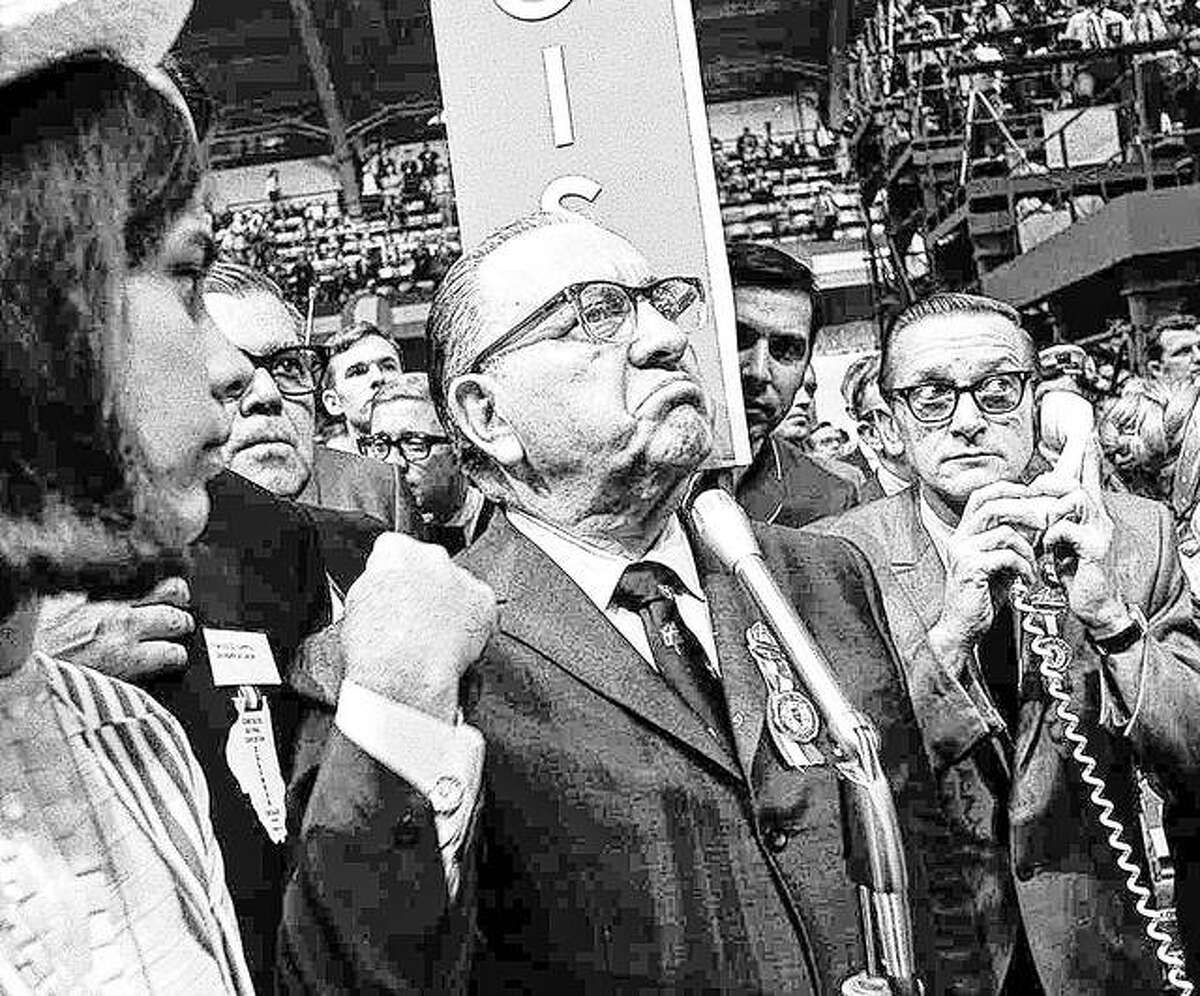A furious Mayor Richard J. Daley stands at the microphone as shouts resound through the International Amphitheatre on Aug. 28, 1968, in Chicago, demanding the Democratic National Convention adjourn until later in the day before considering the party platform. Daley contended spectators in the galleries were doing the shouting. Daley was seated front-row center, directly below the rostrum. It was the position of honor; but it was also ground zero in a year of political and social upheaval.