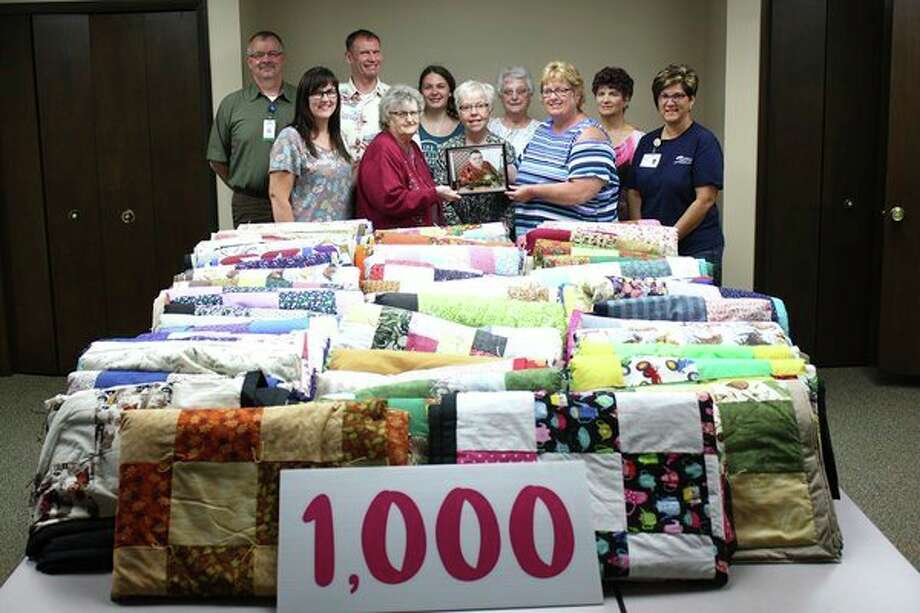 United Hospice Service staff pose with Brenda Miller, her family and members of Charlie's Angels Quilting Group.(Submitted Photo)