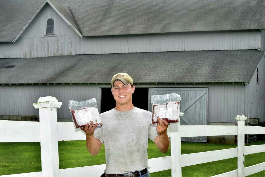 "Milford, Connecticut - Friday,  August 2, 2018: Cristian (CQ) Mortali of Orange, a former employee of Shamrock Farm in Orange, holds  frozen cryovac packages of USDA inspected organic beef from Hereford and Simmental Cattle at Jim Zeoli's Shamrock Farm in Orange. Because of Mortali's suggestion, the beef from Shamrock Farm is used in the ""Shamrock Burger"" served at the Orange Ale House in Orange. Photo: Peter Hvizdak / Hearst Connecticut Media / New Haven Register"