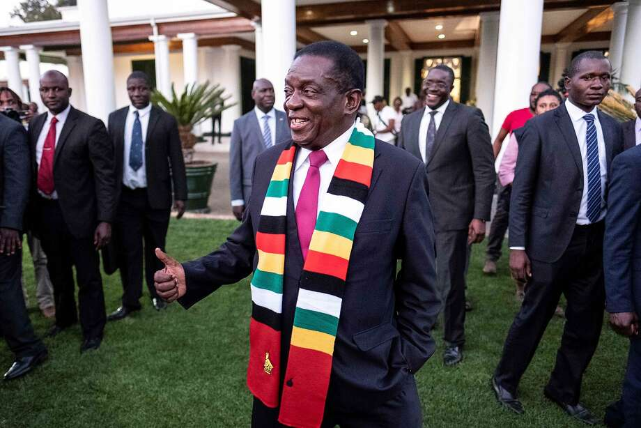 Zimbabwe President elect Emmerson Mnangagwa smiles in the garden of The State House in Harare on August 3, 2018, at the end of a press conference. Mnangagwa defended the landmark election in which he was declared victorious, despite claims from the opposition of vote-rigging. / AFP PHOTO / MARCO LONGARIMARCO LONGARI/AFP/Getty Images Photo: MARCO LONGARI;Marco Longari / AFP / Getty Images