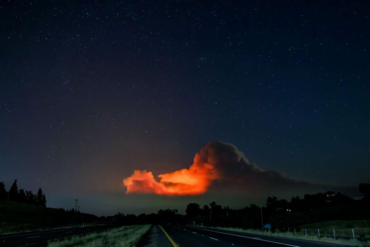 Smoke clouds from the Ranch Fire portion of the Mendocino Complex Fire, which is burning in the Mendocino National Forest, is illuminated at night with the stars visible, in Lakeport, Calif., on Aug. 1, 2018. (Marcus Yam/Los Angeles Times/TNS)