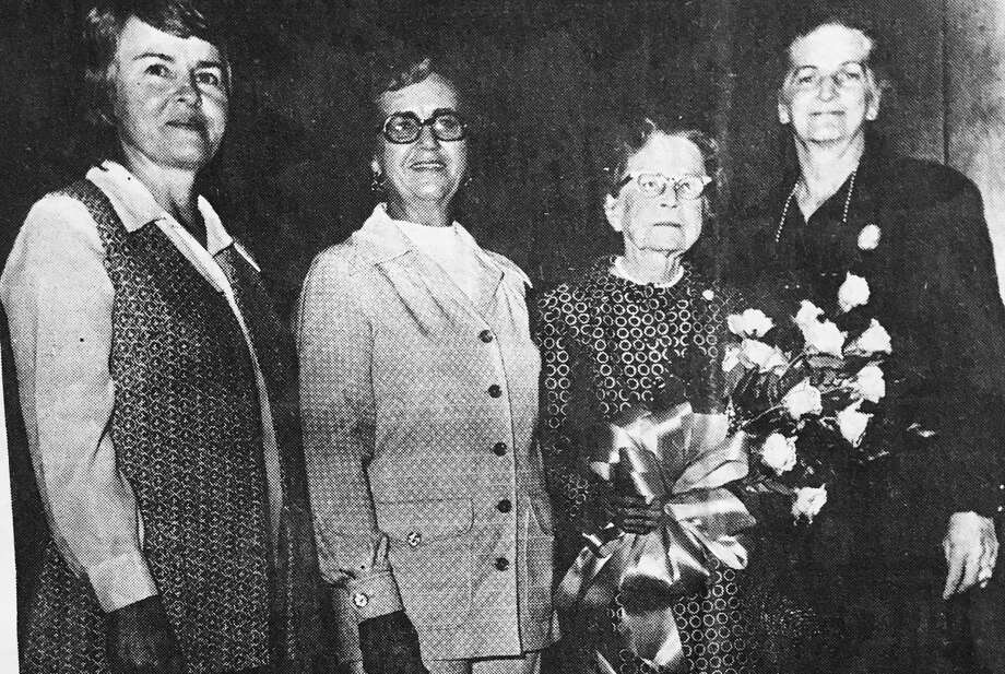 The Conroe Art League presented Mrs. Charles Harritt Jr. with a dozen roses in gratitude for the use of the Wahrenberger Building during a Lone Star Art Guild Show. She was the daughter of the late John Wahrenberger, an early settler and businessman of Conroe. Pictured from left are Belle Stanfill, Weta Rankin, president of the Conroe Art League at the time, Mrs. Harritt and Etta Burns. This picture is from the 1973-75 era of the Conroe Art League. Photo: Photo Courtesy The Conroe Art League